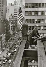 a steel worker atop a tall building